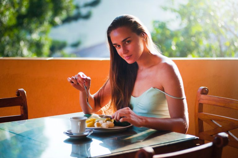 image of woman eating breakfast